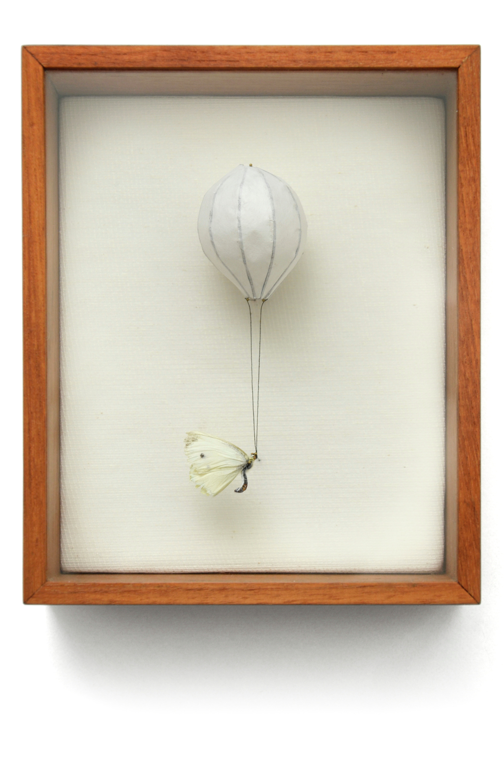 """White Air"" has a balloon filled up with white air. It helps the little butterfly to rice up. (w:14 h:17 d:5.5 cm)"